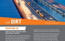 The Dirt newsletter cover with round IMCO logo and orange heading box, I-90 roadway with dramatic lighting and floating bridge