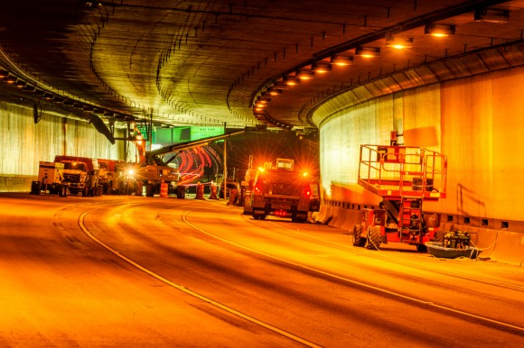 I-90 tunnel with work trucks