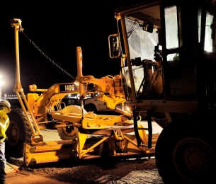Construction Road Grader at Paine Field Airport Runway at night