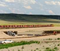long cargo train on northern Montana railroad near construction