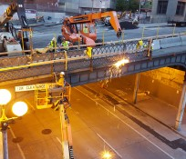 IMCO construction crew working on Yesler Bridge over 4the Avenue South in Seattle