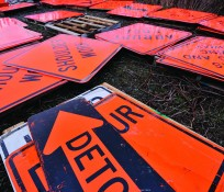 orange and black construction safety signs