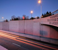 Blaine overpass at US-Canada border with text reading Welcome to the United States of America