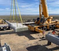 Heavy equipment placing concrete panels