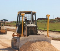 Tiyan Parkway construction crawler tractor pushing dirt