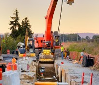 Excavator and Steel Pipes Installation