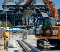 Excavator at Amtrak Maintenance Facility construction site near Safeco Field